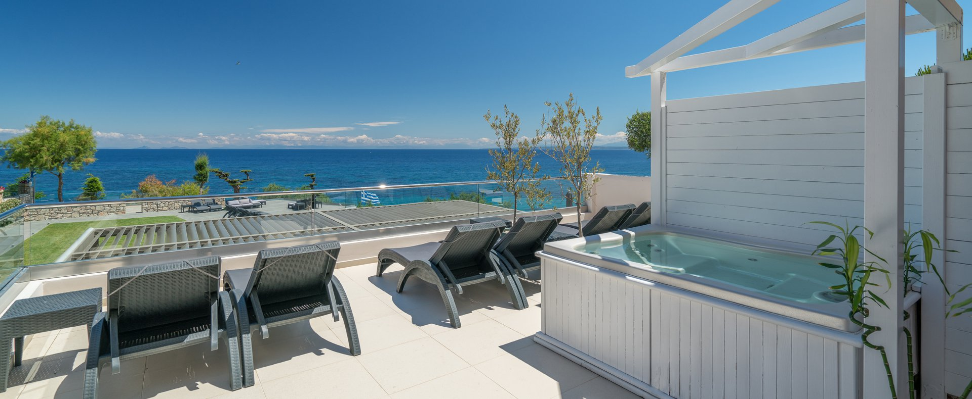 Veranda with sunbeds facing the Ionian Sea at Kymothoe Elite Suites in Zakynthos