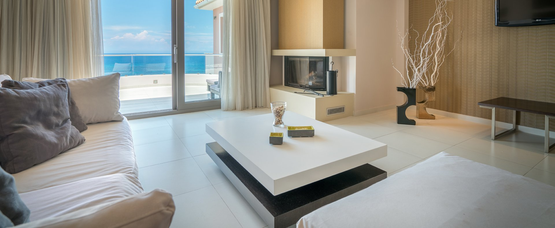 The cozy living room with a sea view that Kymothoe Elite Suites offers in Zakynthos