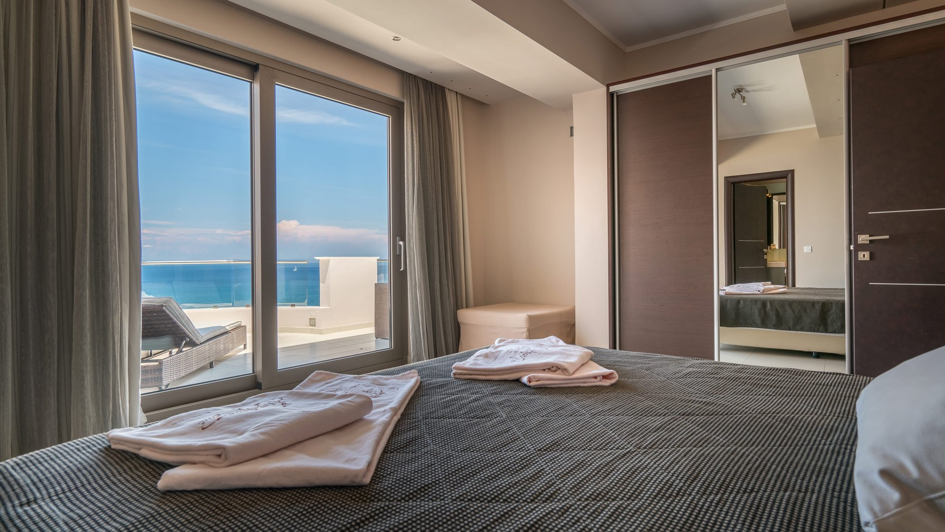 The bedroom and its view of the Ionian Sea that Kymothoe Elite Suites offers in Zakynthos